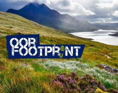 Scottish highland loch landscape with 'oor footprint' graphic in foreground